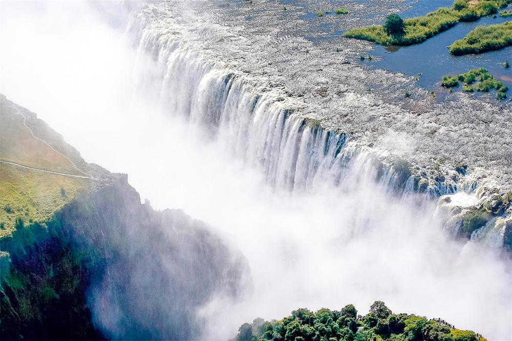 One of the star activities when visiting the mighty Victoria Falls Zambia is to take a swim in Devil's Pool! Don't miss an opportunity for adventure travel by swimming right on the edge of these falls. | Africa travel, Devil's Pool Zambia