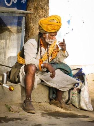 An Indian man sips a chai tea on a break.