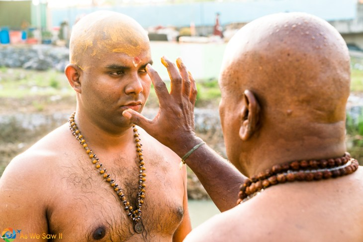 Heads shaved, father and son prepare. Thaipusam 2017, Batu Caves