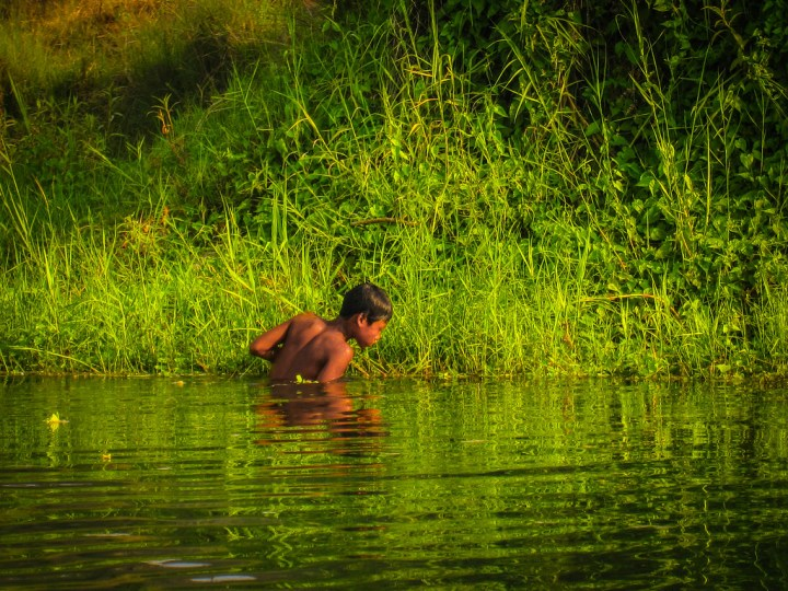 boy fishing in the early morning