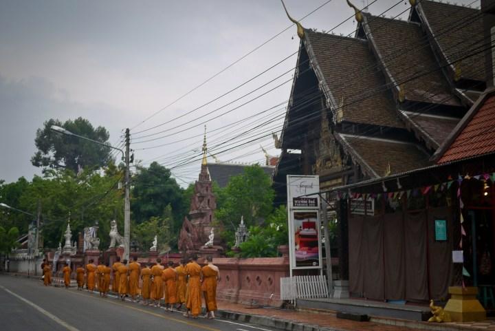 monks taking alms in thailand