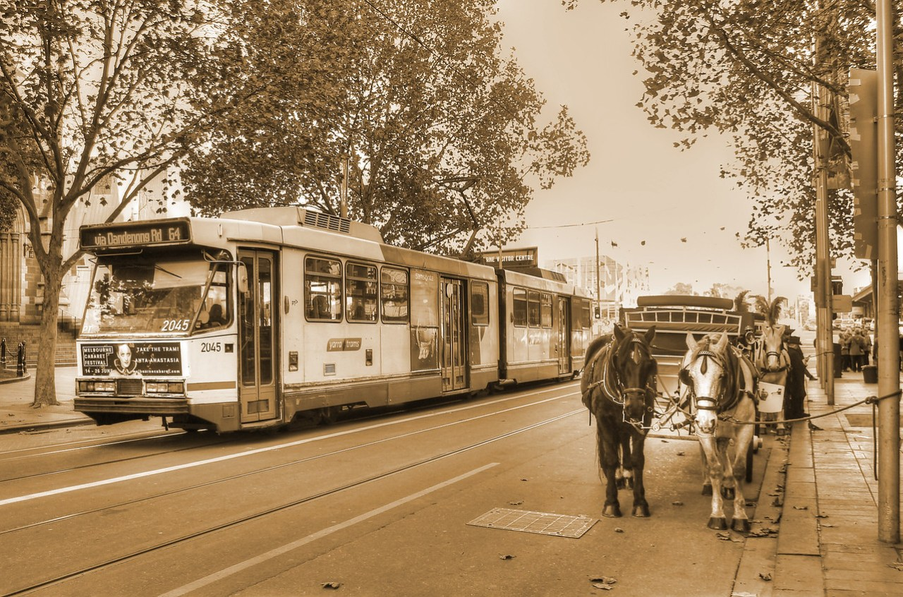 Tram and horse and carriage on Swanston Street in Melbourne, Australia