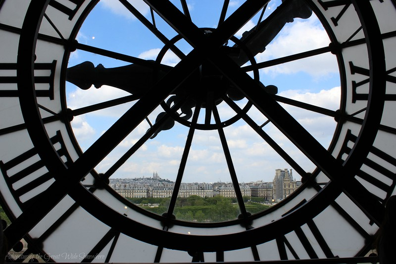 View of the Louvre and Sacre Coeur from Behind La Cloche at the Musee D'Orsay