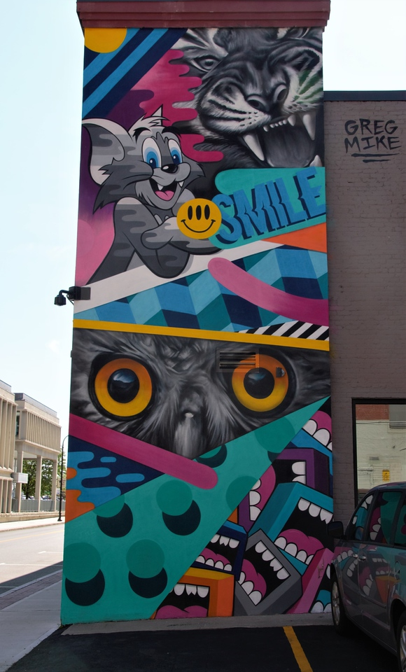 Pow! Wow! Worcester mural of a tiger, an owl, and Tom from Tom and Jerry
