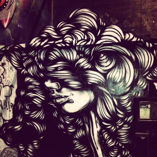 woman street art in East London