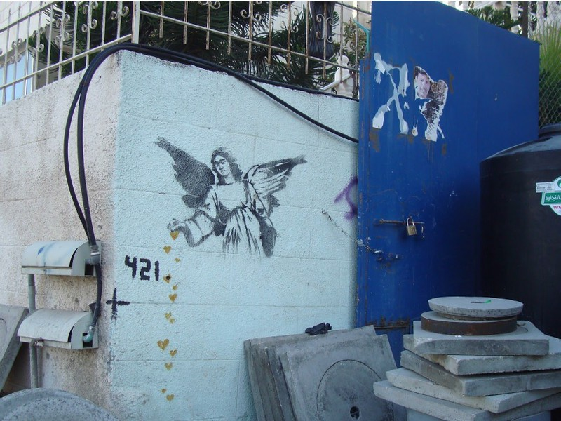 street art of an angel in Palestine