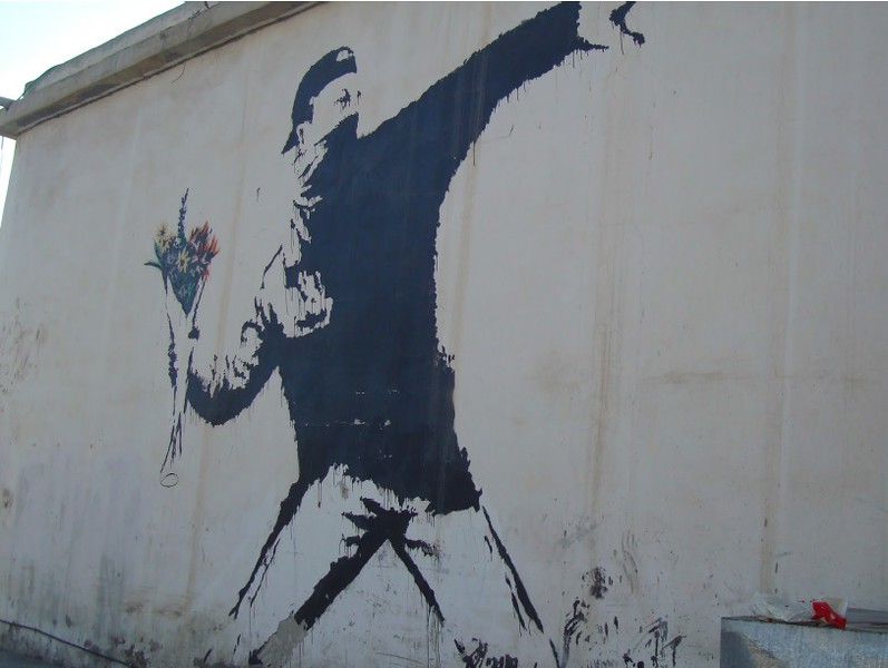 Throwing flowers mural on wall
