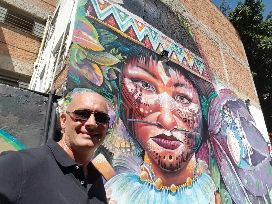 Scott posing by Aztec street art