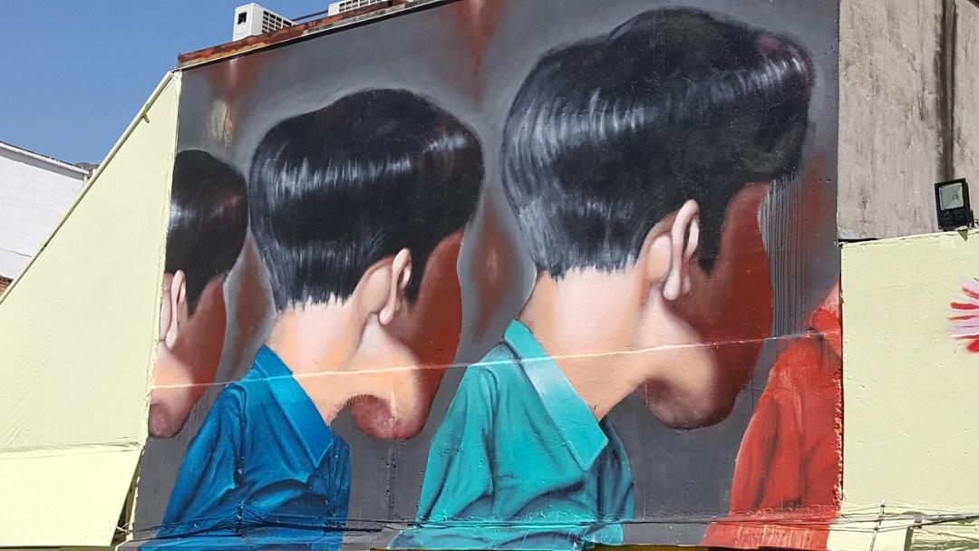 Mural of Brazilian boys facing away