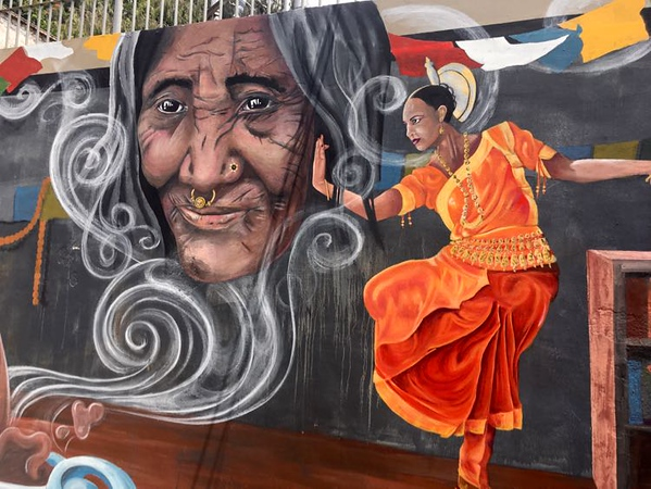 Best street art in Nepal of a woman dancing
