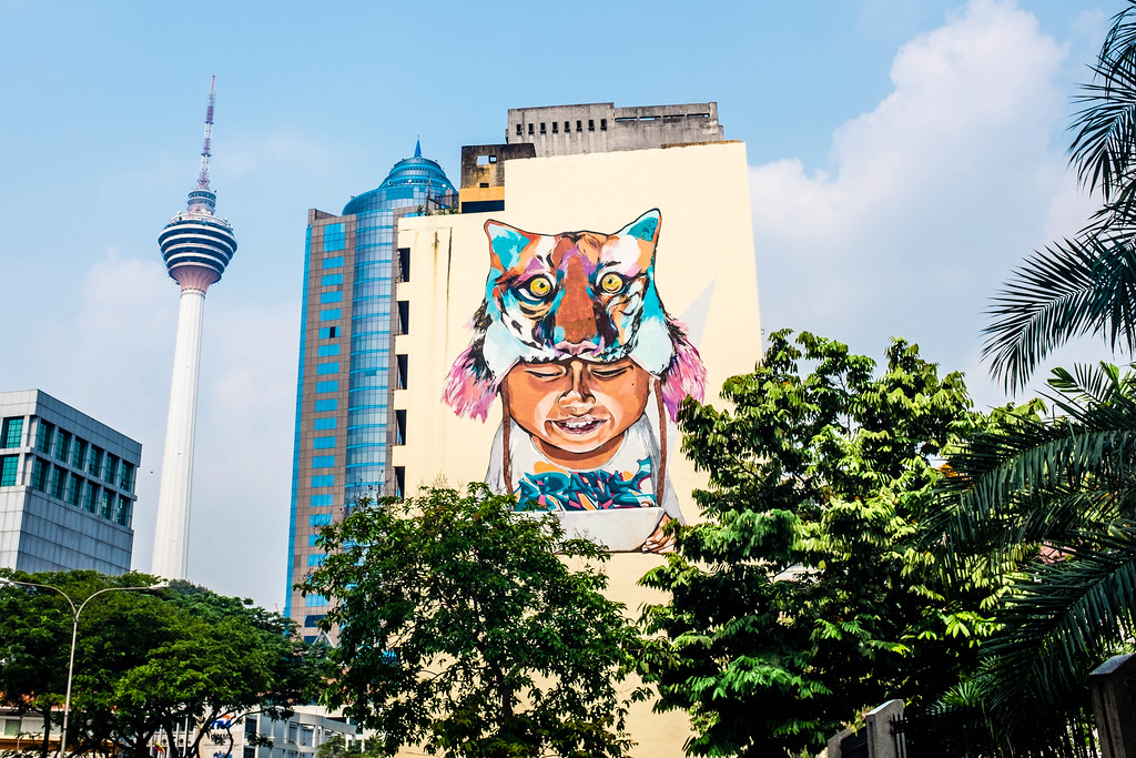 Anokayer and Yumz - Boy with Tigerhat street art