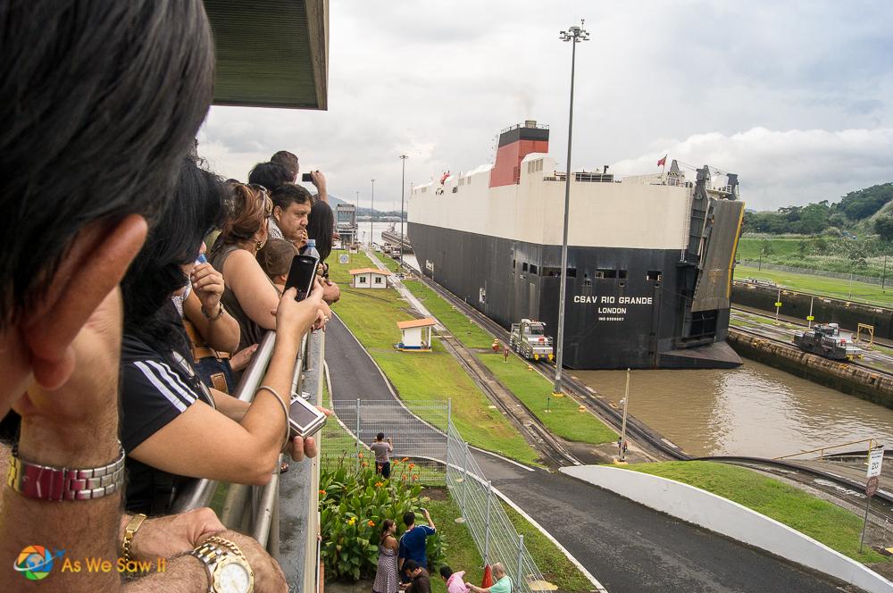 Visitors watch ships transit Miraflores Locks at the Panama Canal