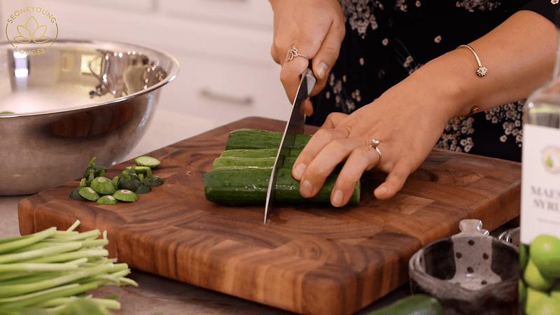 Vegan Cucumber Kimchi - cutting cucumber