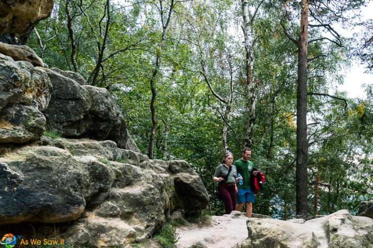 Linda and Vitek hike on a path in Bohemian Switzerland State Park, Czech Republic