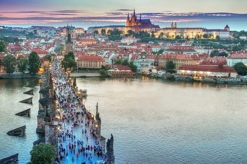 sunset from up high in prague of charles bridge