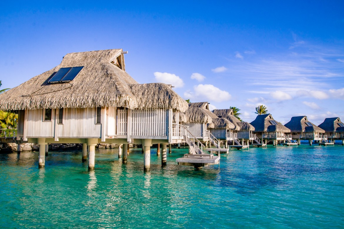 Do you think the overwater bungalows and villas look like the ultimate romantic setting for your next couples vacation? Check out our pros and cons of these popular accommodations! | www.eatworktravel.com - The luxury, adventure travel couple!