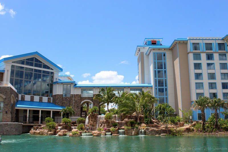 Exterior of the Loews Sapphire Falls Resort from across the turquoise lagoon water.