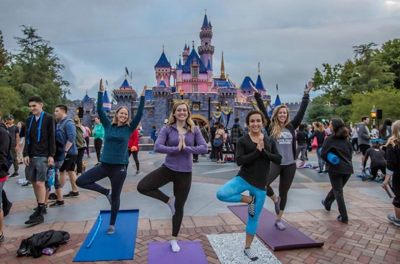 For International Yoga Day, June 21, 2019, more than 1,000 Disneyland Resort cast members registered to practice yoga in front of Sleeping Beauty Castle at sunrise. (Josh Sudock/Disneyland Resort)