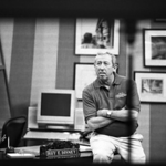 "Roy E. Disney at his desk; 1997 My office was 2 doors over from Roy's office, in the ""hat"" building. He was shooting an intro for ""The Wonderful World of Disney"". Roy was waiting patiently for the camera crew to setup and I took this photo through a small window."