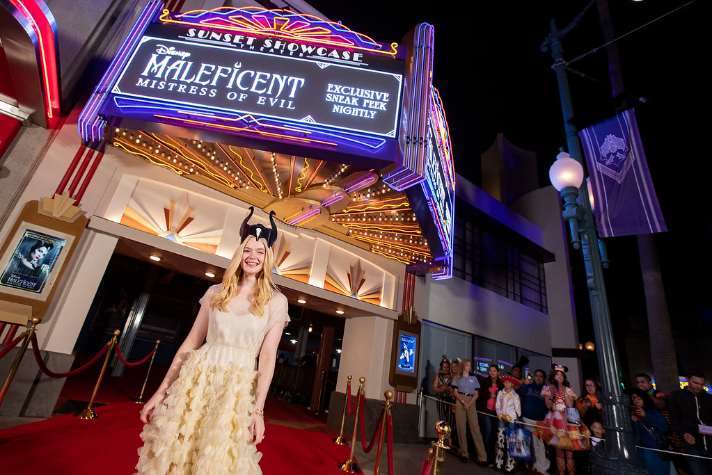 Actress Elle Fanning Surprises Disneyland Guests during 'Maleficent' Sneak Peek