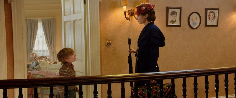 Emily Blunt is Mary Poppins and Joel Dawson is Georgie Banks in Disney's MARY POPPINS RETURNS, a sequel to the 1964 MARY POPPINS, which takes audiences on an entirely new adventure with the practically perfect nanny and the Banks family.