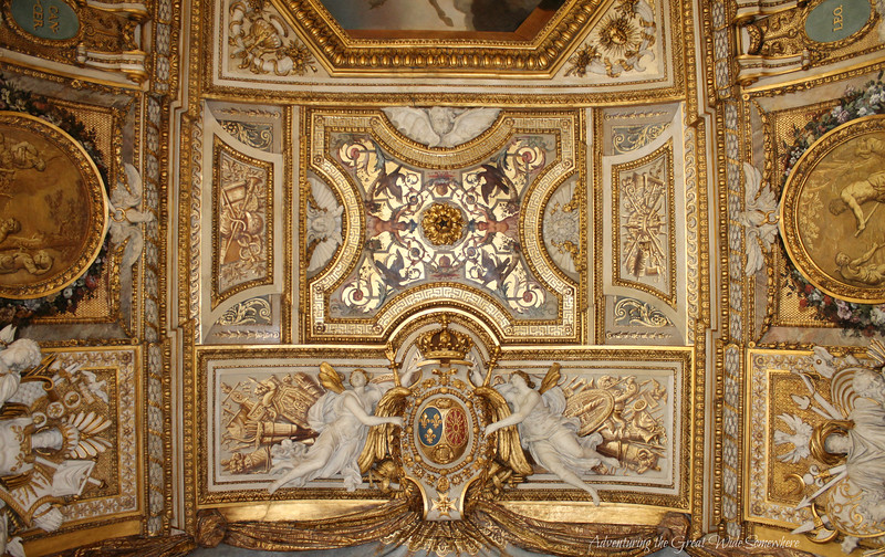 The gold-detailed ceiling of the Apollo Gallery, shining, shimmering, splendid.