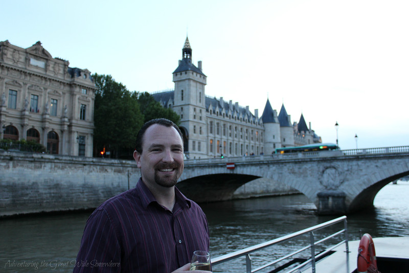 Dan enjoying a glass of wine on the top deck of our Bateaux Mouches dinner cruise in Paris