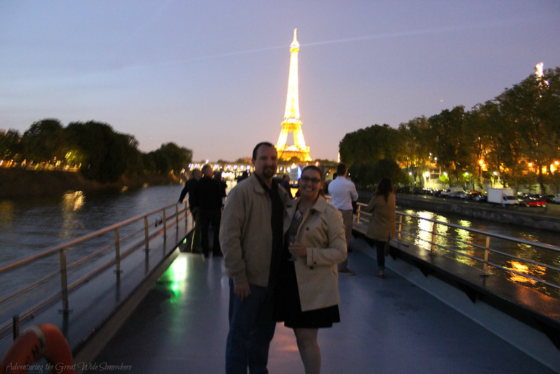 Dan and I enjoying some wine on the top deck of our Bateaux Mouches dinner cruise, with the Eiffel Tower sparkling behind us