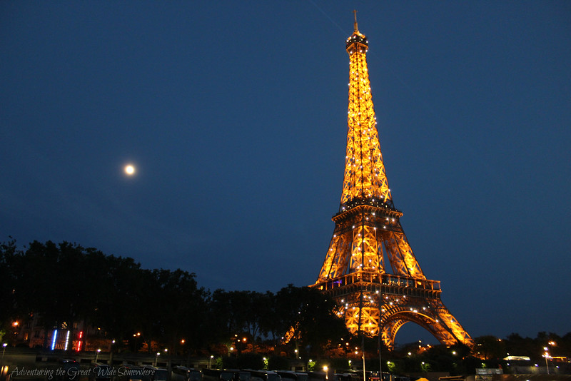 The gorgeous Eiffel Tower, sparkling brilliantly in the twilight