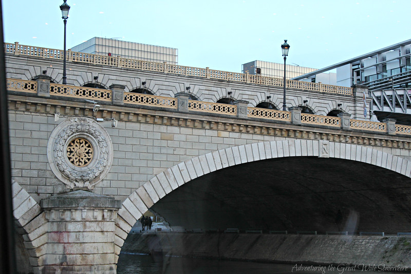 One of the many beautiful bridges running across the Seine River in Paris