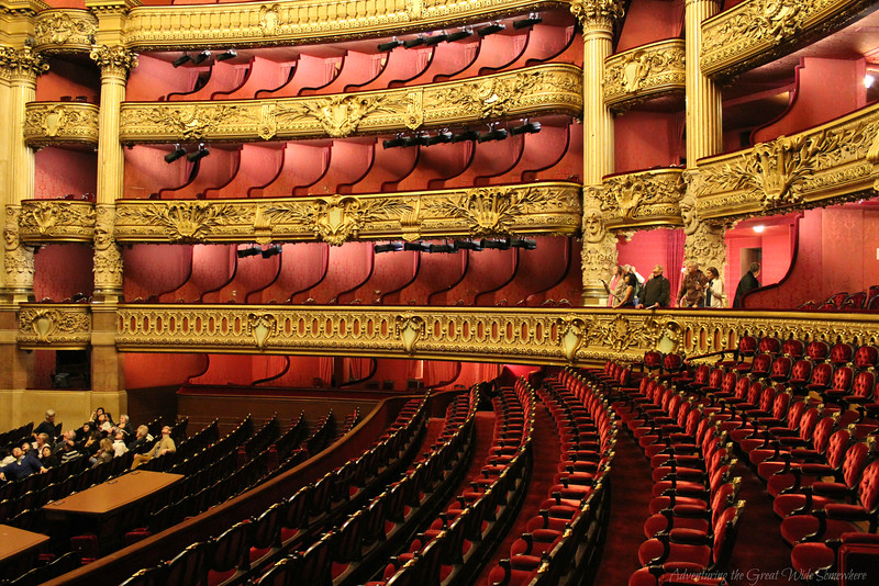 Rows of lush red velvet theater seats at the Palais Garnier in France