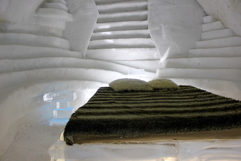 bed with fur blanket in the ice hotel in quebec city