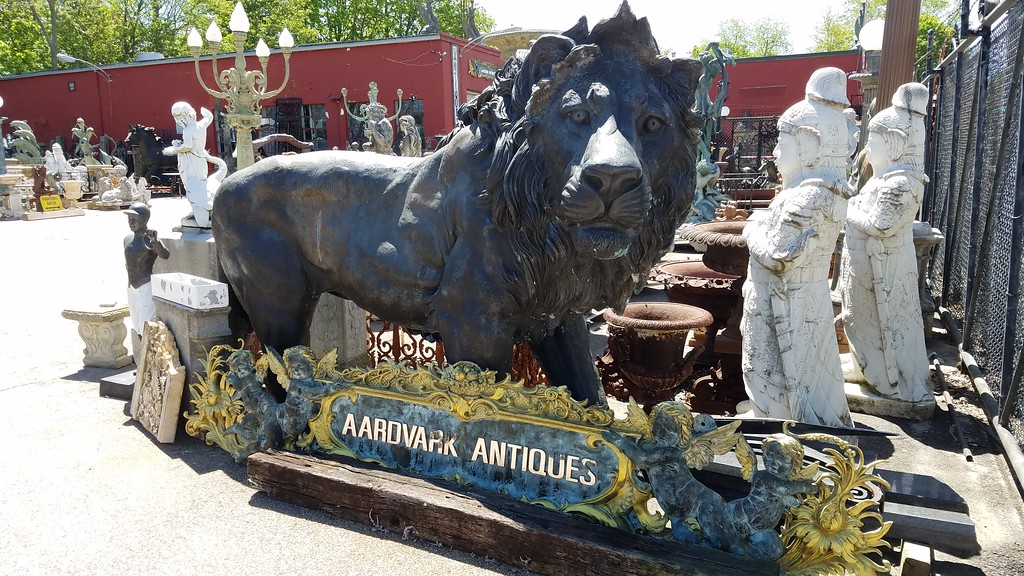 Aardvark Antiques with lion guarding