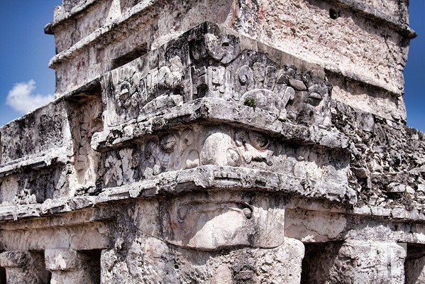 Tulum Diving God Stone carved face