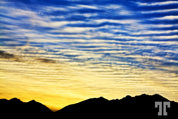 Rippled clouds over the Mohave Desert mountains in Arizona
