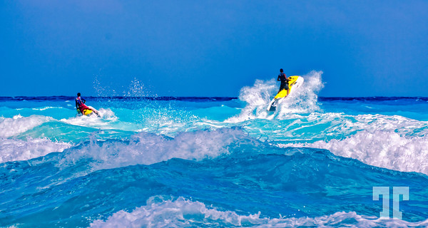Jet ski jumping over the waves in Cancun, Mexico