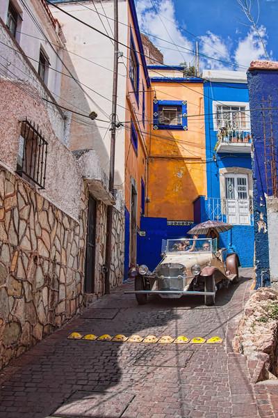 Narrow streets and Mercedes car in Guanajuato, Mexico