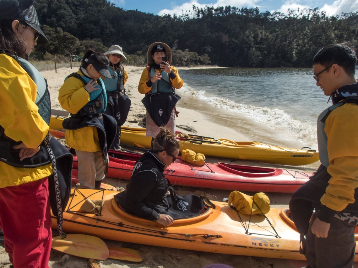Our Guide, Michelle, Demonstrates how to get into the Kayak