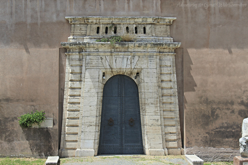 A stunning blue side door to the Castel Sant'Angelo in Rome, Italy