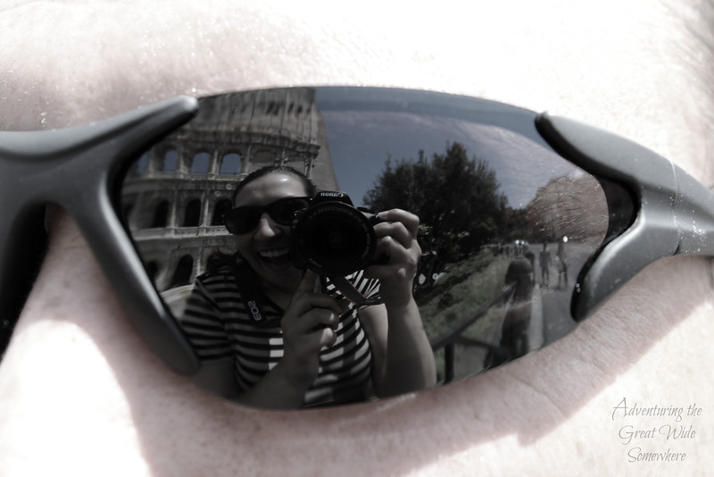 My cheesy, camera-toting self reflected in Dan's sunglasses