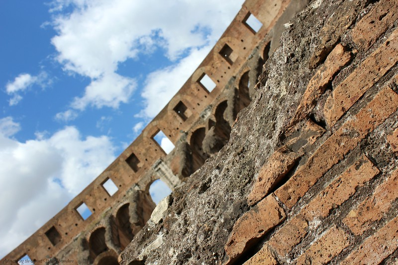 Artistic Shot of the Worn Brick and Windowed Walls of Rome's Iconic Colosseum
