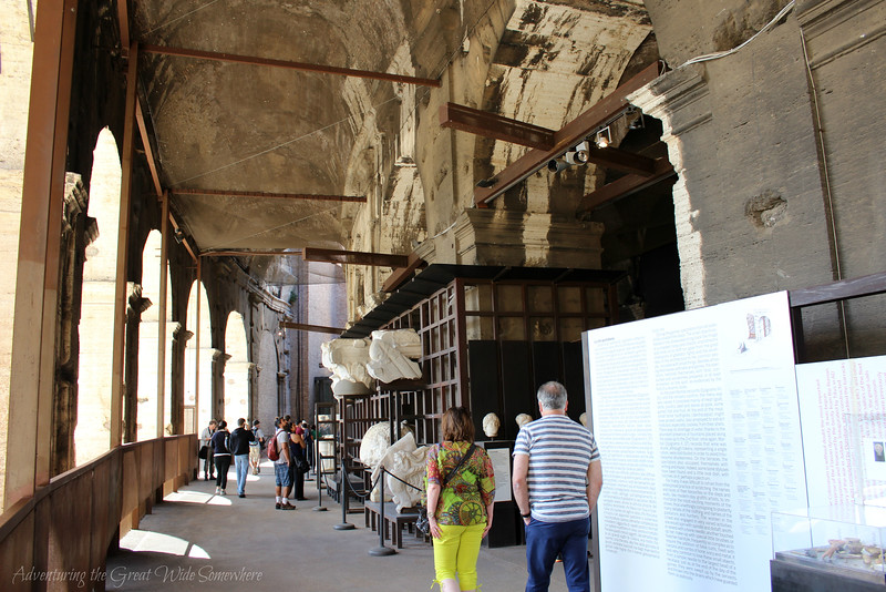 Visitors strolling past interesting exhibits on the history of Rome's beloved Colosseum