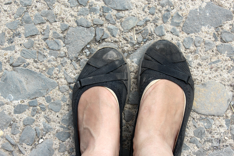 My worn down, dusty black flats at the end of a two week trip through Europe. These stayed comfortable the whole time! Great traveling shoes.