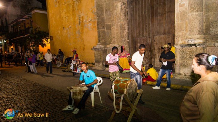 Street entertainers play for tips as night-goers find Cartagena fun and exciting.