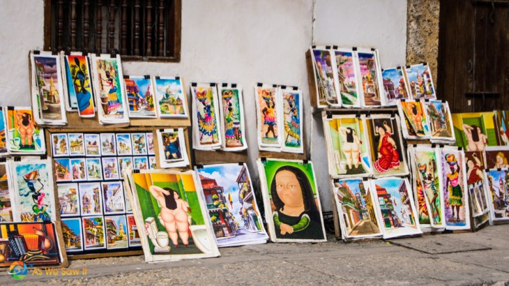 Artist sells her renditions of Colombian art on a street in Cartagena.