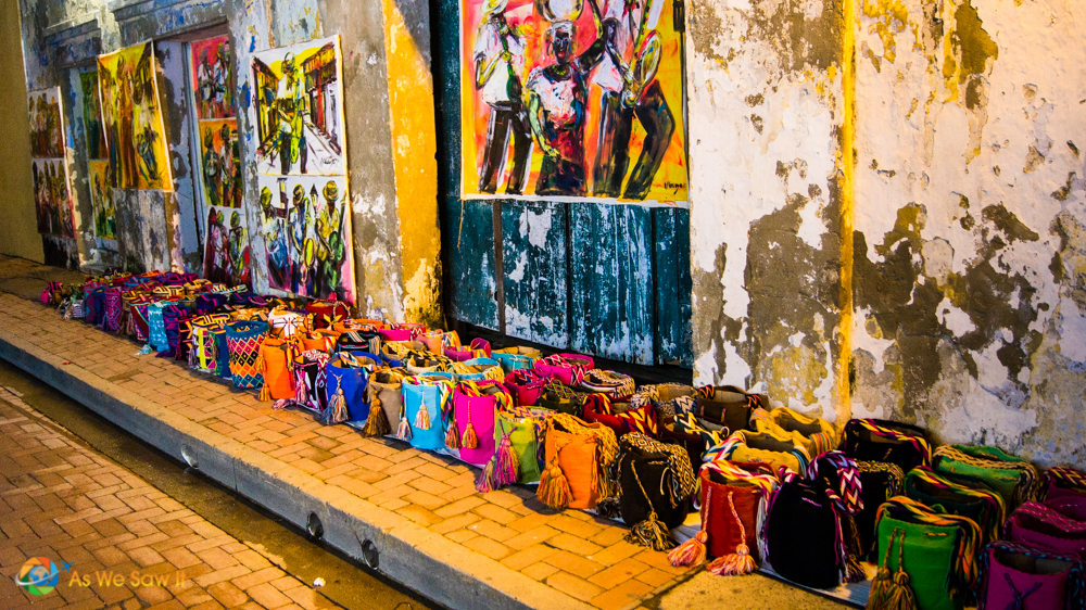 Even at night the colors pop out from the streets as vendors continue to provide beautiful crafts for lucky tourists in Cartagena.
