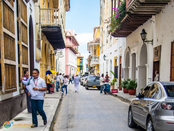 Bustling tourists and local workers scrambling along the narrow streets of Cartagena.