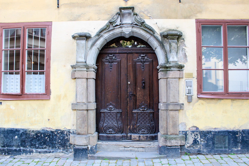 stockholm old town has a lot of cool doors that make you feel like you're in the middle ages