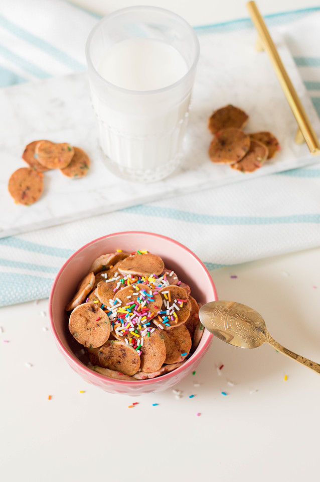 People are making mini pancakes into Pancakes Cereal, and you can too! This rainbow sprinkled recipe is perfect for birthdays, special occasions, and more!