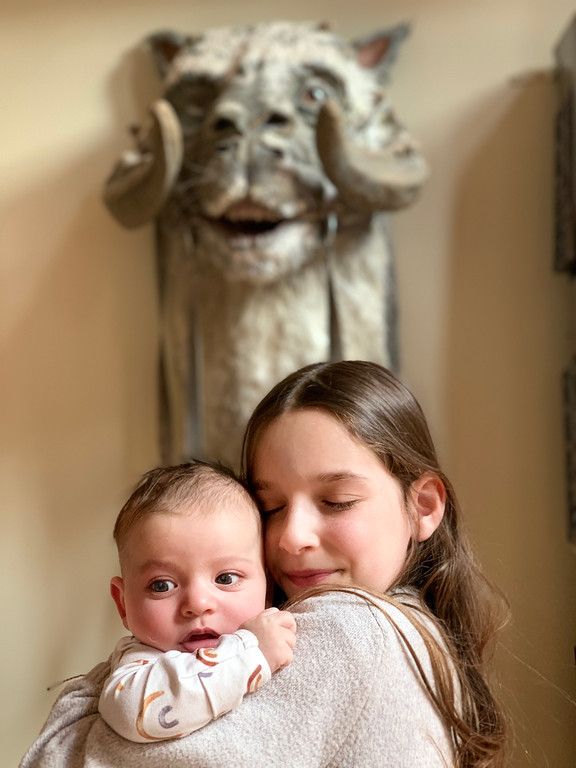little girl hugging baby
